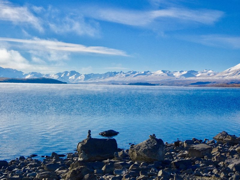 At Lake Tekapo, the Southern Alps are as far as the eye can see.