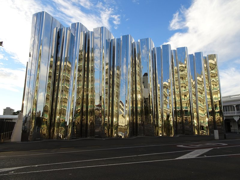 In 2015, the Len Lye Center opened in New Plymouth; it is the first gallery in NZ to be devoted to the work of one artist, Len Lye. The artist was born in Christchurch, but became a naturalized US citizen. He is known for his work with film and kinetic sculptures. The new building was added onto the already existing Govett-Brewster Art Gallery. It is made of curved stainless steel and concrete; it is supposed to resemble a theater curtain.