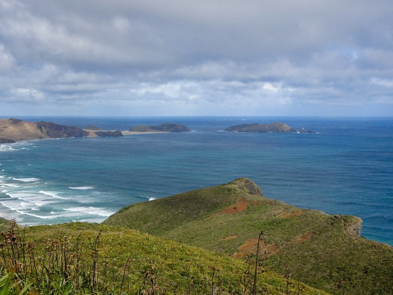 Looking to the west, Cape Maria Van Diemen is at the northern tip of 90-Mile Beach. Close to the shore is Motuopao Island; it was the original site of the lighthouse, before it was moved to the Cape Reinga point.