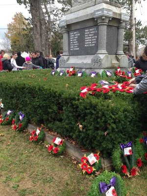 On side of the pedestal with the engraved names - also the wreaths with poppies