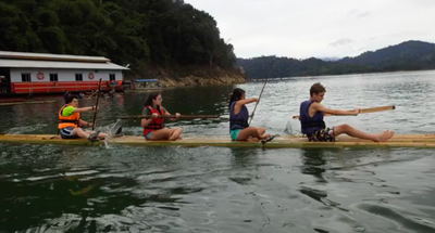 The team paddling out into the lake