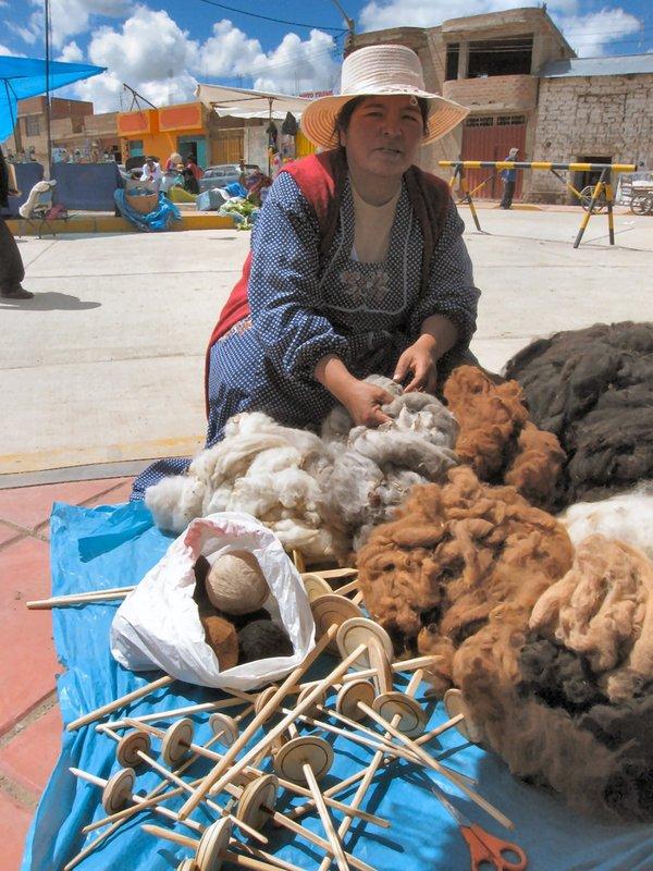 Alpaca fiber farmer and vendor at the Acora market in Peru.