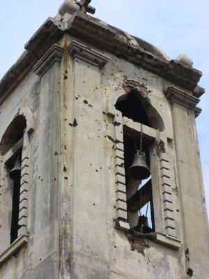 bullet holes in belltower