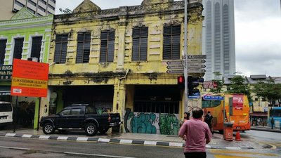 Marley Bar down this yellow building street