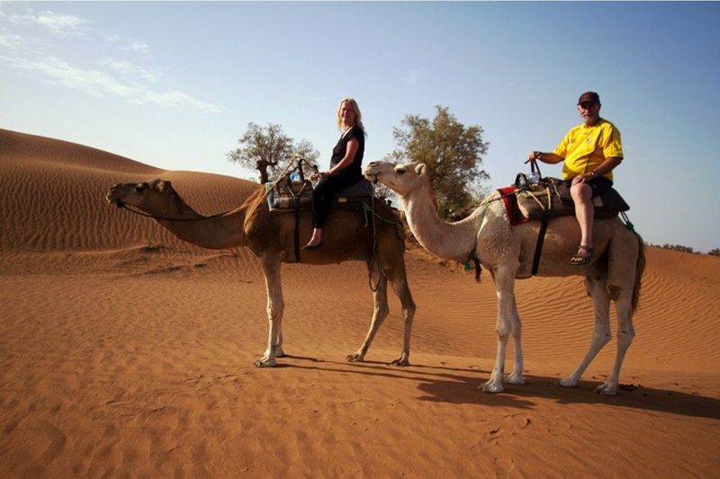 aussirose and Howie ride camels out of the Desert - Morocco