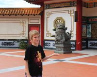 Jesse holds up Statue Chin Swee Genting Highlands - Kuala Lumpur