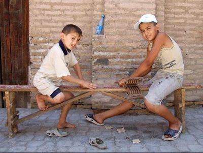 3608497-Young_woodcarvers_Khiva_Khiva.jpg