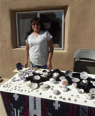 5914885-Pottery_seller_Acoma_Acoma_Pueblo.jpg