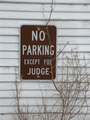 6034720-Sign_on_Courthouse_Cimarron.jpg