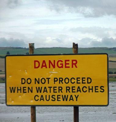 6324222-Warning_by_causeway_Lindisfarne.jpg