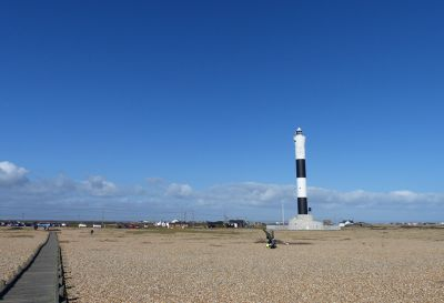 7008530-New_lighthouse_and_fisherman_Lydd.jpg