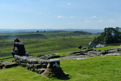 7464345-Tourist_admires_the_view_Housesteads.jpg