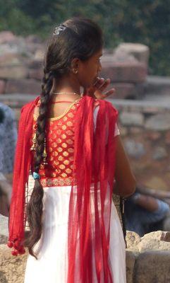 7516396-Tourist_at_Qutb_Minar_Delhi.jpg