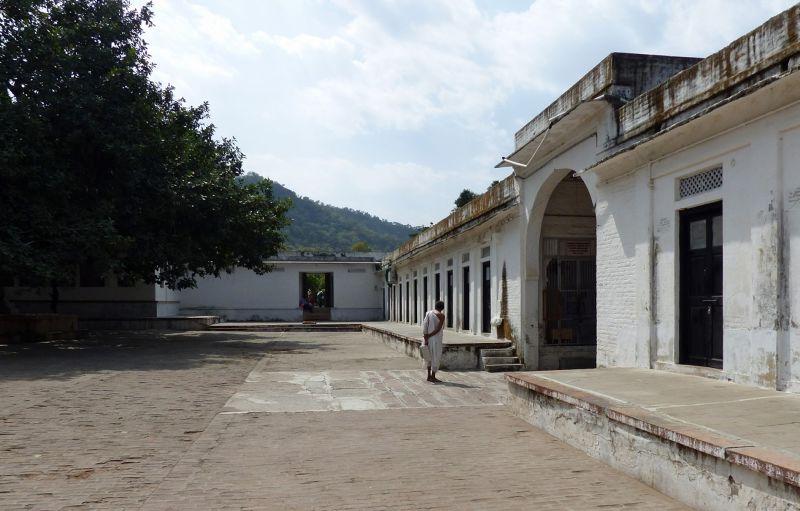 White-clad Jain in temple grounds - Ranakpur