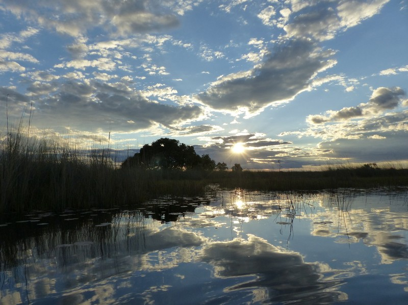 The sun goes down over the Okavango Delta