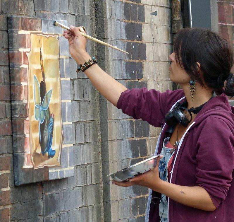 Street artist at work in Shoreditch