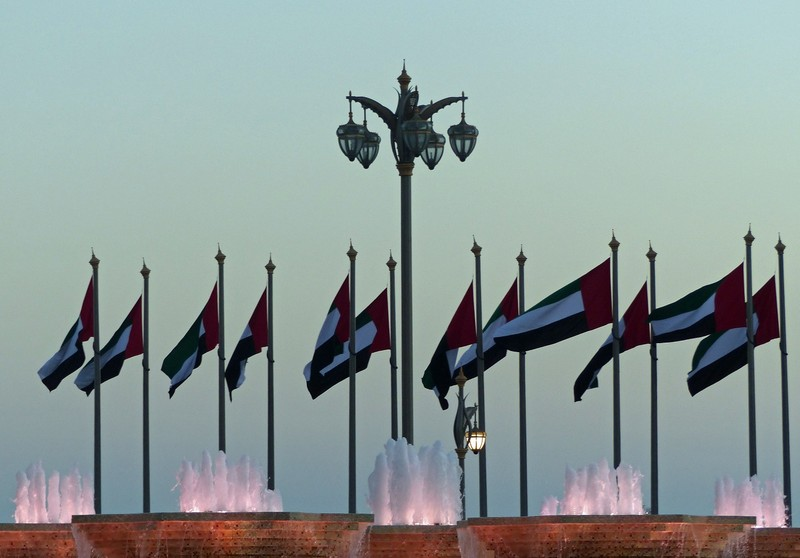 Fountains at the Presidential Palace gate at sunset, Abu Dhabi