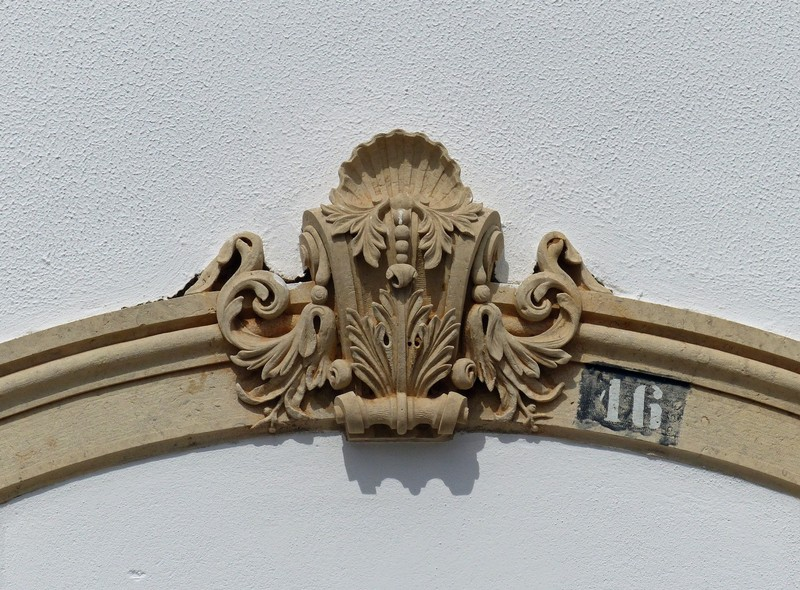 Above a door in Faro, Portugal
