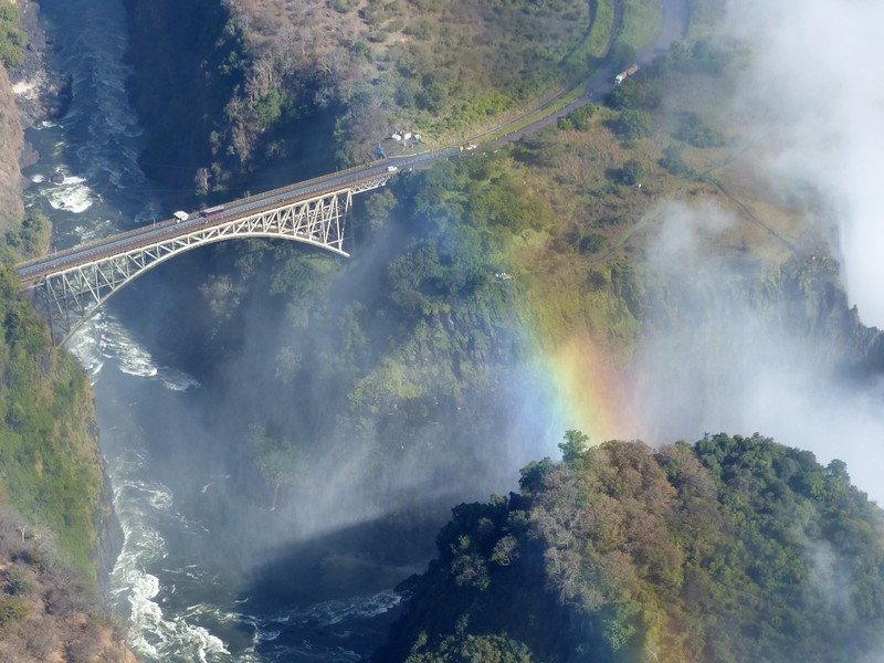 Helicopter flight above Victoria Falls - rainbow and bridge