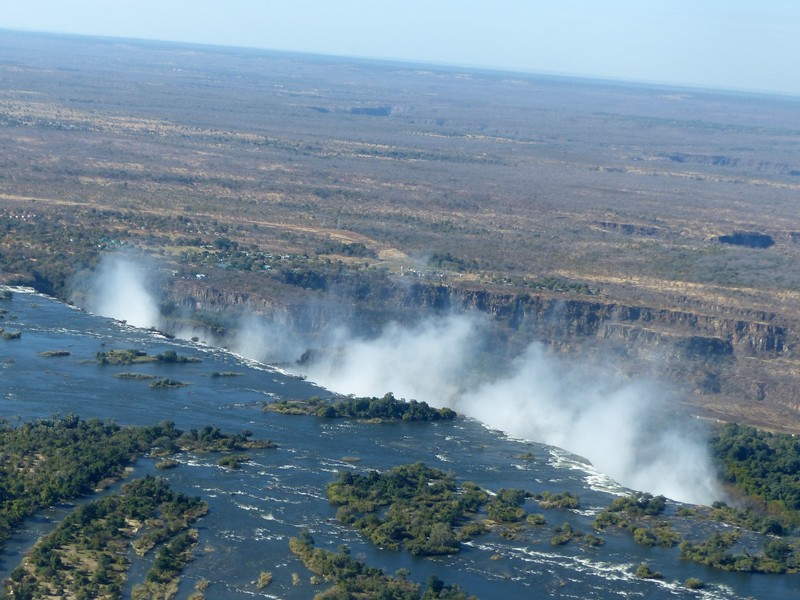 Helicopter flight above Victoria Falls - the spray rises above the Zambezi