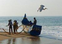 Fishing boat and fishermen, Chowara beach
