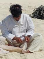 Mending the nets on Al Haffa beach