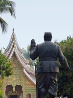Statue of Sisavang Vong, Royal Palace, with Haw Pha Bang behind