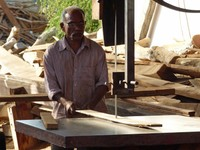 Carpenter at the dhow shipyard, Sur
