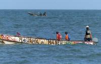 Fishermen seen from the beach, Ngala Lodge