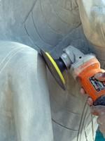Sanding down the carving, Santuk