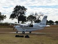 Kodiak plane on the airstrip, Xugana Island Lodge