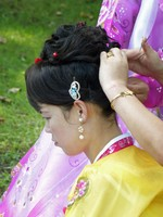 Bride having her hair fixed in Moranbong Park on National Day