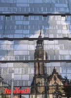 The Evangelical Reformed Church reflected in a shopping centre window, Leipzig