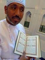 Said with a copy of the Quran, Sultan Qaboos Mosque, Muscat