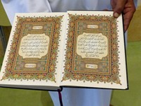 Hussain with a copy of the Quran, at the Sultan Qaboos Mosque, Salalah