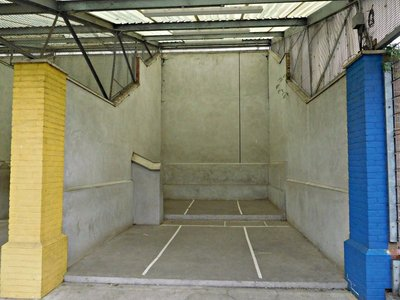 Under Westway / A3220 interchange. An Eton fives court