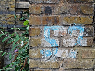 Air raid shelter marking on Former East London Synagogue now Temple Court