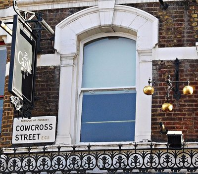 Cowcross St and pawnbrokers sign