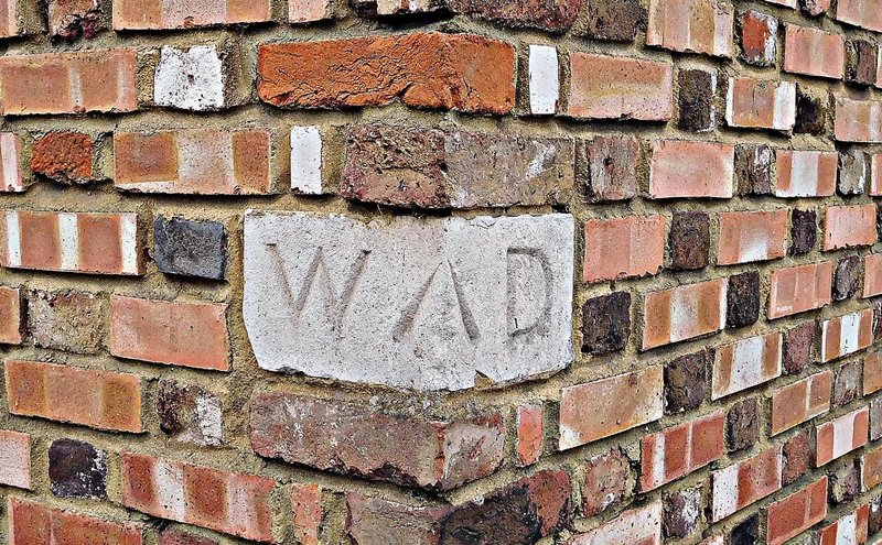 'WD' stone Just west of Francis Greene House