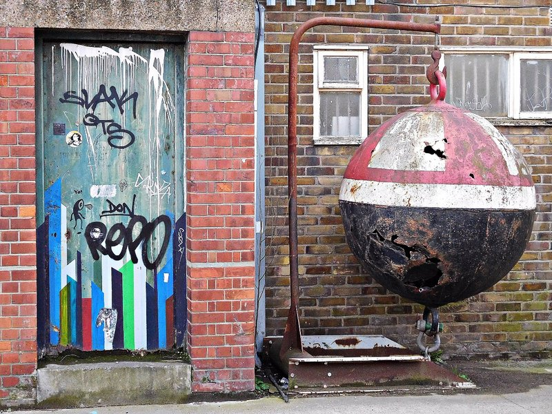 Painted door and spherical buoy