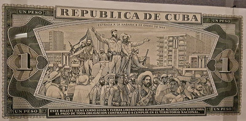 Cuban note with revolutionary scene