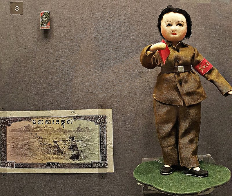 Cambodian note with bazookas and a Chinese doll
