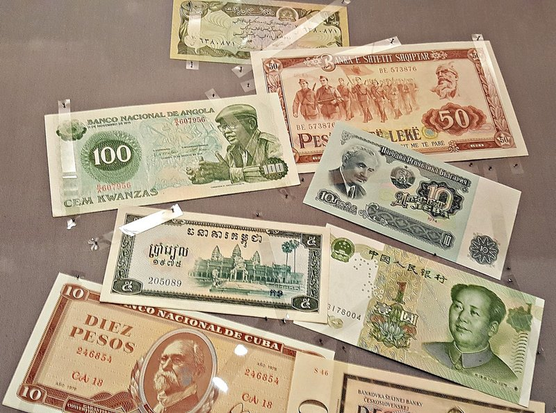 Assorted banknotes including an Albanian one