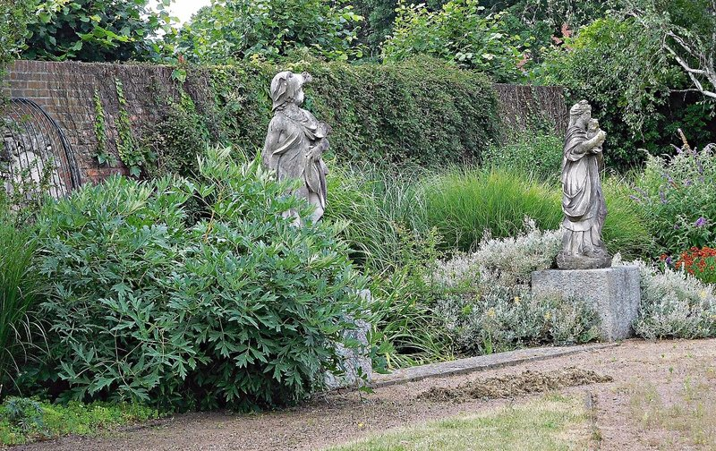 Statues inside Pymmes walled garden