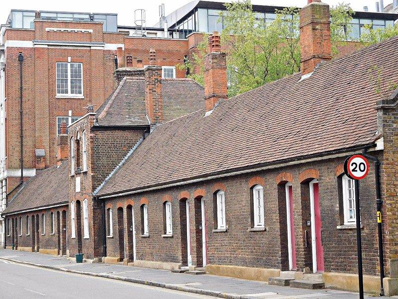 Almshouses Southwood Lane with Highgate School Science Block behind