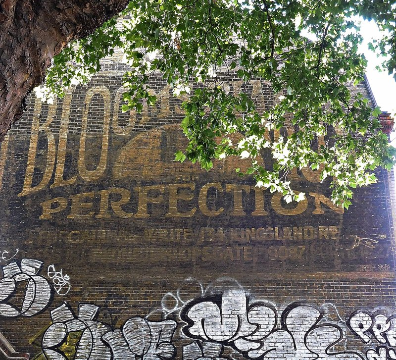 Old ad for Blooms pianos south side Geffrye Museum