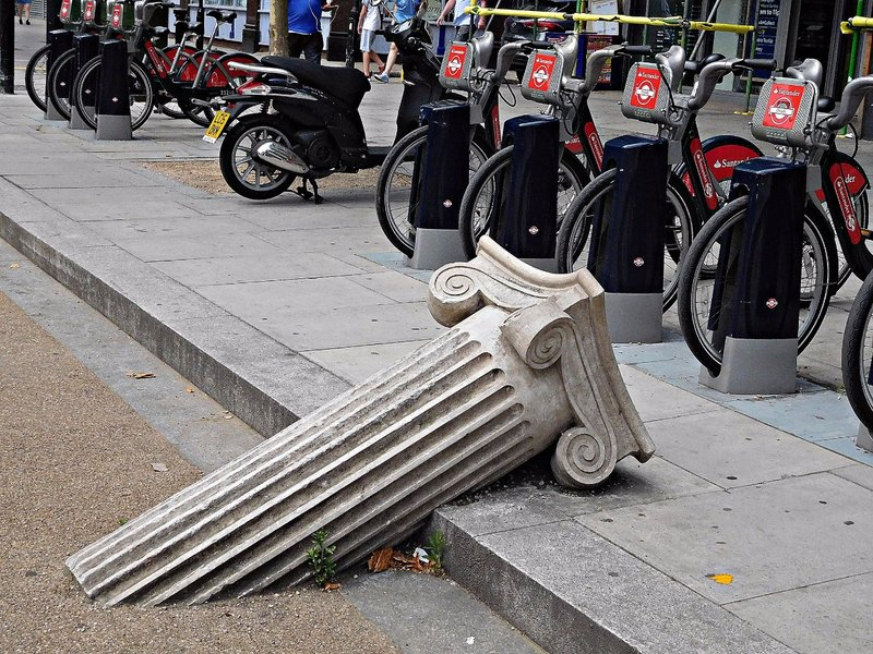 Sunken pillar in Mile End Rd near Genesis cinema