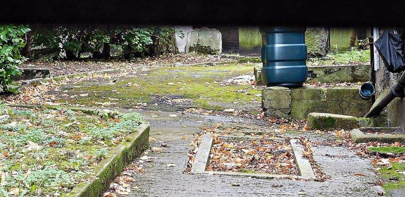 Alderney Rd Cemetery through the letter box flap