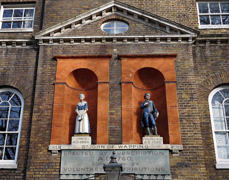St Johns Churchyard Wapping:  school detail - Bluecoat uniforms