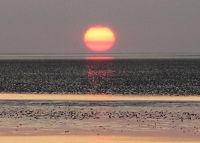 The sun turns into a big orange - Cuxhaven